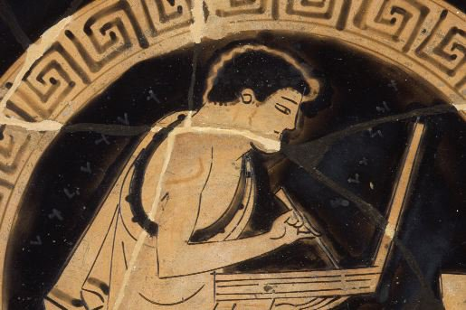 Young man writing on tablet